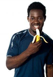 Fit Guy Eating A Banana